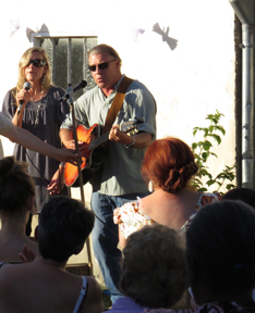Sharing a song at a baptism in St. Cyr-Sur-Loire, France